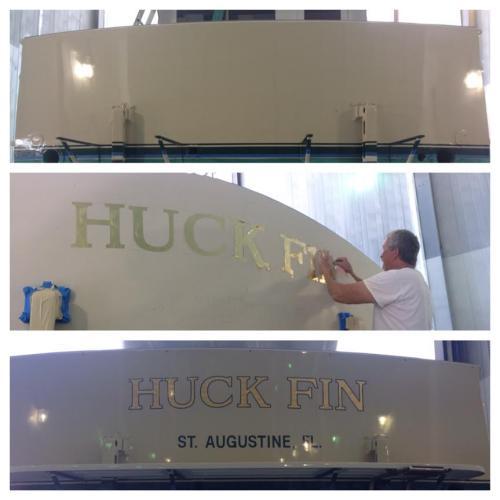 Gold leaf name on 53' Huckins Sportsman